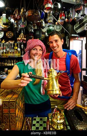 Tourist buy souvenirst, Al Balat, Amman, Jordan - Stock Photo