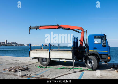 Truck cranes in Shipyards harbor of Trieste in clear weather on a background of blue sky - Stock Photo