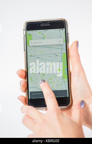 Chicago,IL,USA,Feb-12,2017,Woman hands holding a smartphone with an open Uber map location on the screen   (for - Stock Photo