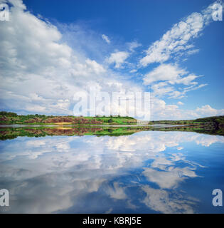 Beautiful lake river and spring green hills. Nature composition - Stock Photo
