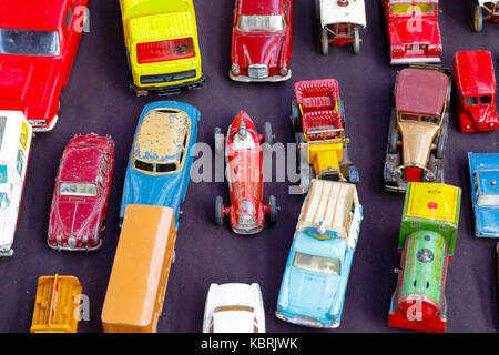 Old toy cars displayed at a junk shop in Old Spitalfields Market in London - Stock Photo
