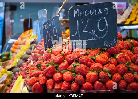Strawberries to sell in market La Boqueria in Bacelona - Stock Photo