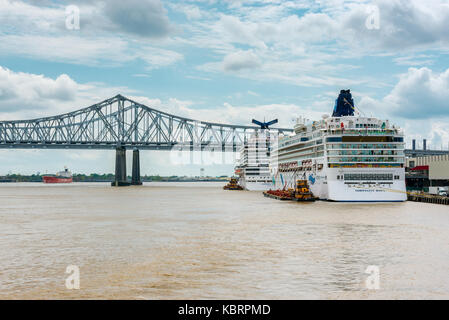 Cruise Ships docked in the Mississippi River in New Orleans, Louisiana, United States - Stock Photo