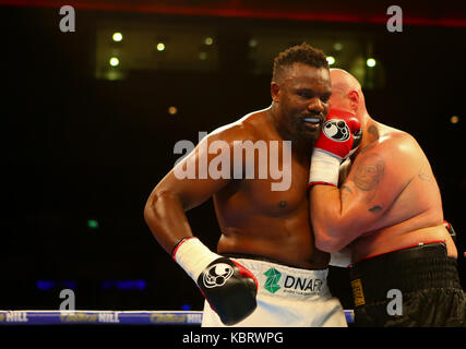Liverpool, UK. 30th Sep, 2017. DERECK CHISORA (WHITE SHORTS) v ROBERT FILIPOVIC during the Heavyweight contest on - Stock Photo