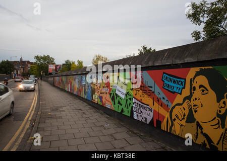 London, UK. 30th September, 2017. One of two colourful murals unveiled today in Dollis Hill to commemorate the 40th - Stock Photo