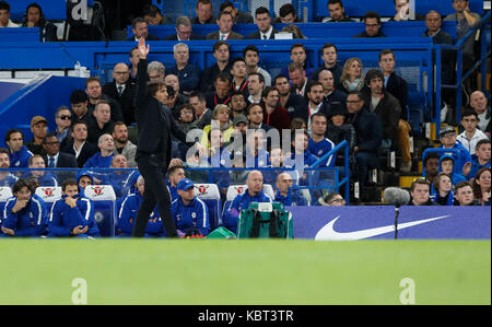 London, UK. 30th Sep, 2017. Chelsea manager Antonio Conte instructs during the English Premier League match between - Stock Photo