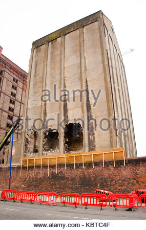 Demolition Work on the former White Tomkins & Courage Grain Silo has been halted after they discovered the building - Stock Photo