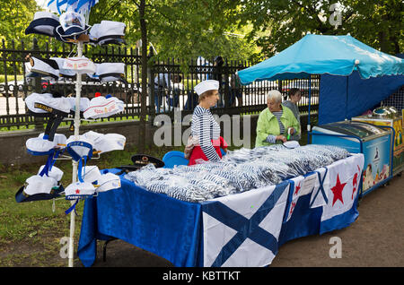 ST. PETERSBURG, RUSSIA - JULY 26, 2015: Day of the Navy in Kronstadt. Two saleswomen sell Souvenirs with marine - Stock Photo