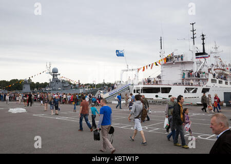 ST. PETERSBURG, RUSSIA - JULY 26, 2015: Day of the Navy in Kronstadt. People stand in line to visit the ship - Stock Photo