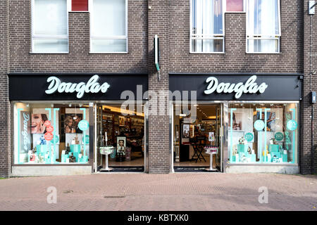 Douglas branch in Gouda, Netherlands. Douglas is a German perfume and cosmetics retailer and has more than 1,700 - Stock Photo