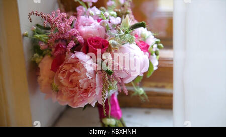 beautiful bouquet of flowers on window sill. beautiful bouquet of pink and white flowers are on the windowsill - Stock Photo
