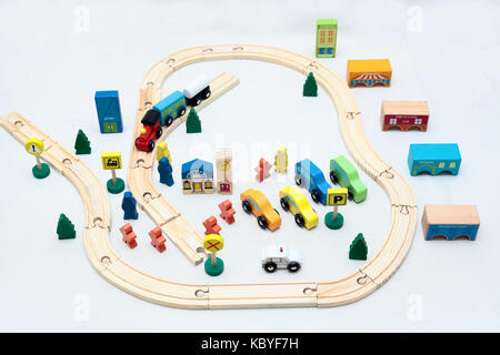 wooden toy city in white background - Stock Photo
