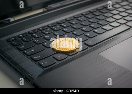 Photo Golden Bitcoins new virtual money Close-up with a computer keyboard. Electronic money mining concept - Stock Photo