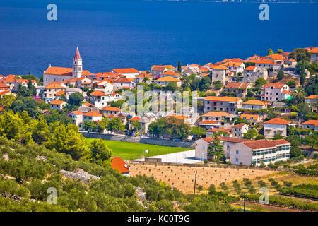 Postira on Brac island skyline view, Dalmatia region of Croatia - Stock Photo