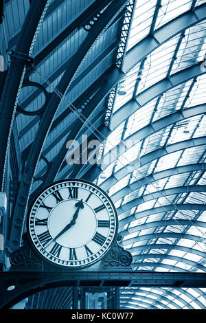 Clock on the  modern building in the subway station - Stock Photo
