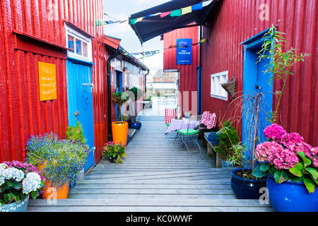 A colourful alley in the fishing village of Henningsvaer, Lofoten, Norway - Stock Photo