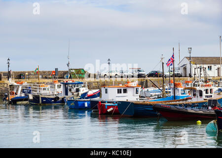 Small fishing boats moored in the harbour at high tide. Tenby, Carmarthen Bay, Pembrokeshire, Wales, UK, Britain - Stock Photo