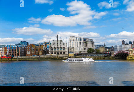 White river cruise tourist sightseeing boat sails along the River Thames by Unilever House and 60 Victoria Embankment, - Stock Photo