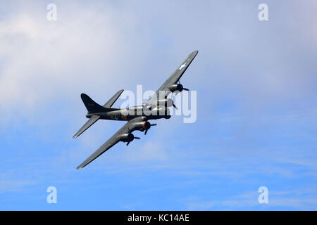 Boeing B-17G Flying Fortress named Sally B in a flypast at the 2011 Bournemouth Air Festival, Dorset UK - Stock Photo