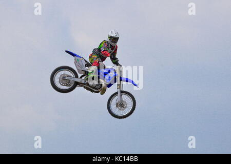 Spectacular motorcycle jumps from the Jamie Squibb Motocross Stunt Show, at the New Forest Show 2011, Hampshire - Stock Photo
