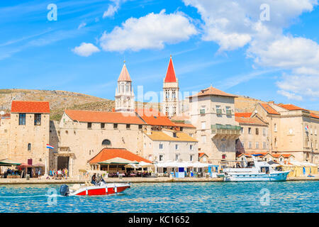 Motorboat sailing on sea along Trogir old town with historic buildings, Dalmatia, Croatia - Stock Photo