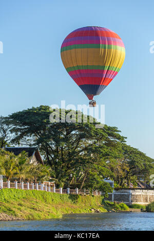Hot air baloon in sky in Vang Vieng, Laos. - Stock Photo