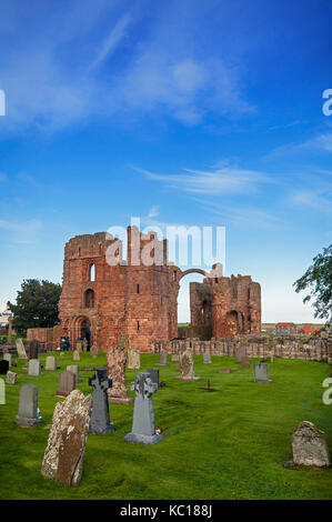 Ruins of the church built about 1150, on the site of 7th Century Lindisfarne Monastery on Holy Island,  Berwick - Stock Photo
