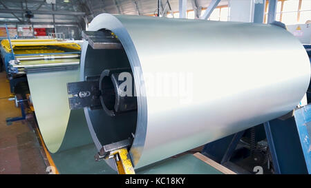 Rolled steel. Stack of rolls, Cold rolled steel coils in action. Galvanized Steel Sheet and rusty rim. Cold rolled - Stock Photo