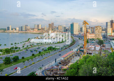 View over the skyline of Luanda with constructions cranes, highway and the Luandan bay, Angola, Southern Africa - Stock Photo