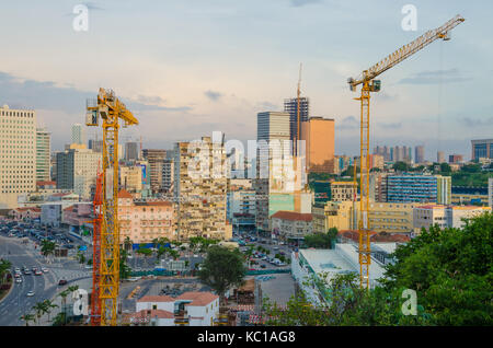 View over the skyline of Luanda with constructions cranes, modern buildings and highway, Angola, Southern Africa - Stock Photo