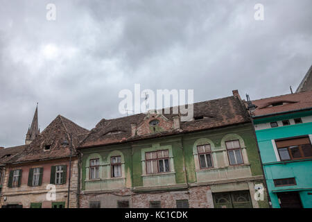 Upper town of Sibiu, in Transylvania, during a cloudy afternoon in a medieval street of the city. The Lutheran Cathedral, - Stock Photo