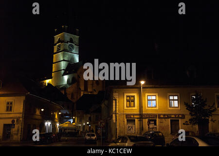 SIBIU, ROMANIA SEPTEMBER 22, 2017: Upper town of Sibiu, in Transylvania, in the evening in a medieval street of - Stock Photo