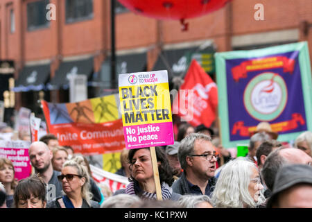 Manchester, UK. 1st October, 2017. Thousands of demonstrators bring the streets of Manchester to a standstill as - Stock Photo
