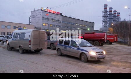 Yakutia, Russia. 1st Oct, 2017. Police cars and fire trucks seen outside the Yakutsk power plant of the Yakustkenergo - Stock Photo