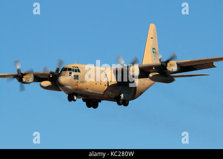 Military air transport. Royal Saudi Air Force Lockheed C-130H Hercules turboprop cargo plane on approach - Stock Photo