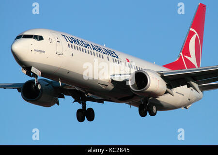 Commercial air travel. Turkish Airlines Boeing 737-800 passenger jet plane on approach. Closeup front view. - Stock Photo