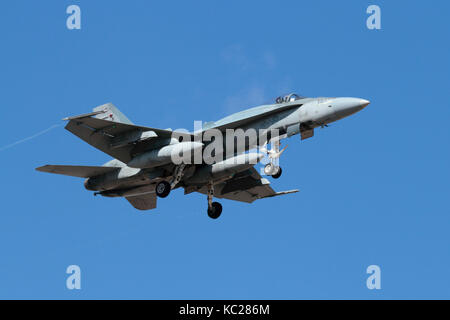 Modern military aviation. Royal Canadian Air Force CF-18 (CF-188) Hornet jet fighter aircraft in flight carrying - Stock Photo