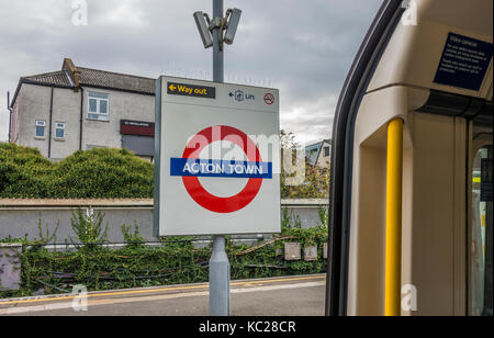 London Underground Acton Town tube station sign on the empty platform, taken from inside the tube train, with nobody - Stock Photo