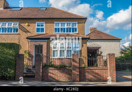 A traditional-build, extended, semi-detached, corner house, located on an ex-council estate in South Ealing, London - Stock Photo