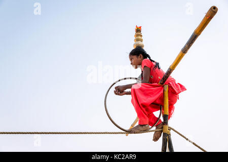 Young rope walker taking a rest, Pushkar, Pushkar, India - Stock Photo