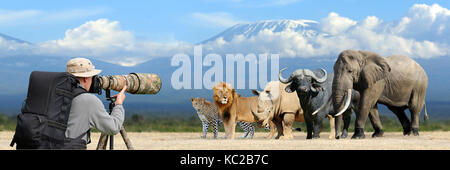 Professional wildlife photographer on safari. Big african five - Stock Photo