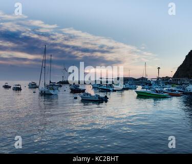 Scenic ocean, island sunrise, bay view of sailboats, yachts, fishing boats in Catalina Island harbor, Avalon, Los - Stock Photo