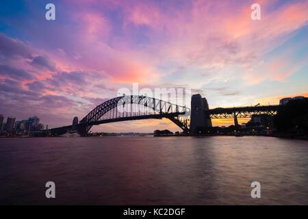 Sydney Harbour Bridge at sunset - Stock Photo