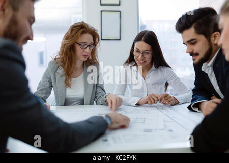 Group of architects working together on project Stock Photo