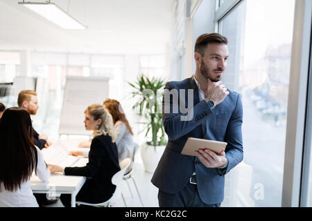 Portrait of young handsome architect on meeting - Stock Photo