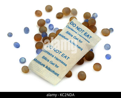Silica gel used as water absorbent over white background - Stock Photo