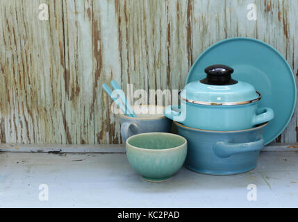 kitchen utensils, cooking pans on a wooden background, rustic style - Stock Photo