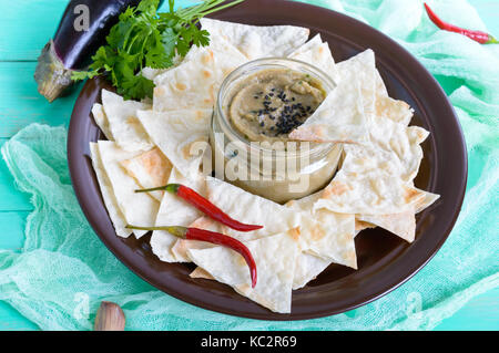Light dietary pate from eggplant. Baba ganush is an Asian dish. Serve with thin lavash on a ceramic bowl. - Stock Photo