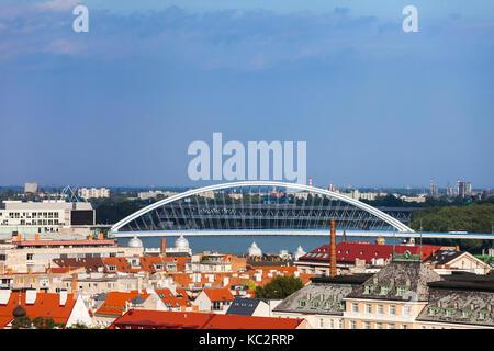 Bratislava, capital city skyline, cityscape with Apollo Bridge, Slovakia - Stock Photo