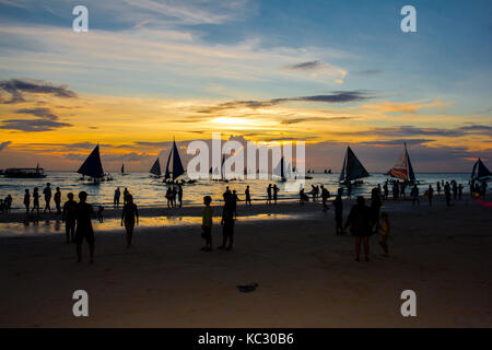BORACAY, PHILIPPINES - 16 SEP 2015: sunset on the tropical beach of the island in south east asia, with Boracay - Stock Photo